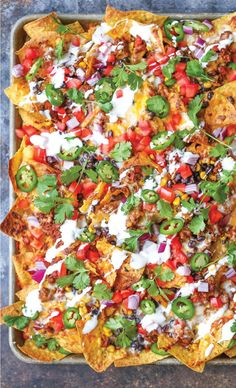 nachos that are guaranteed to be a crowd-pleaser! Simply layer your toppings, bake onto a sheet pan and serve.Loaded nachos that are guaranteed to be a crowd-pleaser! Simply layer your toppings, bake onto a sheet pan and serve. Mexican Food Recipes, Beef Recipes, Cooking Recipes, Drink Recipes, Recipies, Pan Cooking, Cooking Corn, Skillet Recipes, Cooking Light