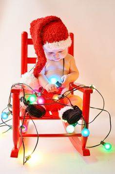 Baby with Christmas lights