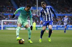 Neymar JR. (L) of FC Barcelona competes for the ball with Theo Hernandez (R) of Deportivo Alaves during the La Liga match between Deportivo Alaves and FC Barcelona at Estadio de Mendizorroza on February 11, 2017 in Vitoria-Gasteiz, Spain.