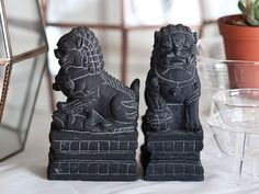 Well.. This is a rare case when a traditional feng shui cure actually looks great in a modern home. These Fu (Foo)  Dogs http://fengshui.about.com/od/fengshuigoodluckcures/ig/Feng-Shui-Fu-Dogs/  look quite good, don't you think? :)
