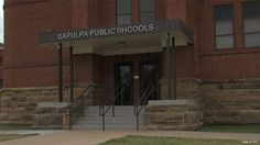 A sign at an Oklahoma school system's administration building is turning some heads