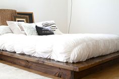 A Floating Platform Bed Frame from Pereida-Rice Woodworking PICTURED: Queen size solid wood floating platform bed frame and headboard set, stained