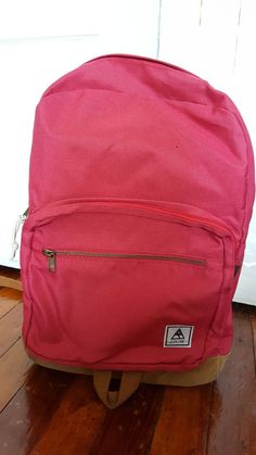 2 zippers on the front, 1 big compartment, laptop sleeve (not padded), 2 pockets inside. If you would like more pictures or information, just send me a message and I would be more than happy.
