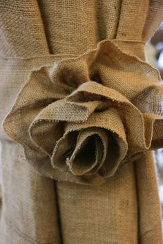 burlap flower curtain tie backs! Oh I love this! They would be so cute over cream colored curtains in my living room!
