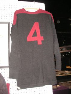 football jersey, c1930, black with maroon trim, number 4 on the back $750.00. Had a Spalding tag.