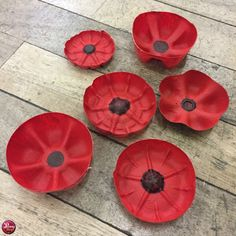 Plastic poppies created from recycled plastic drinks bottles. Plastic poppies created from recycled plastic drinks bottles. Poppy Craft For Kids, Art For Kids, Crafts For Kids, Remembrance Day Activities, Remembrance Day Poppy, Plastic Bottle Flowers, Plastic Bottle Crafts, Recycle Plastic Bottles, Wreath Crafts