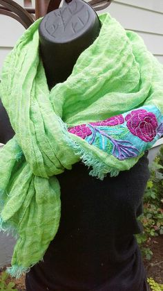 Thin, loose weave Lithuanian linen scarf in delicate green - almost chartreuse- with a speck of yellowish linen has a fashionable wrinkled effect on both ends, it has applique in Indian vintage teal cotton embroidered in silk with lovely rose pattern the wrinkled contemporary effect