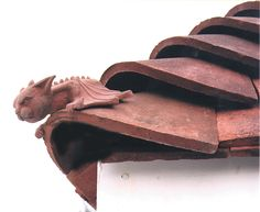Terracotta Bat Hip Tile. Love this little fella! #clay #finials--Heads up ceramic artists! I can't find ANYONE in the States making these and only one company that carries them-the only manufacturer in the States does the plain chimmeny pots.