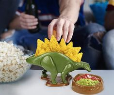 Drastic times call for Jurassic measures! Our pterribly fun Nachosaurus Nacho Dip and Snack Dish Set is a gift from the dino gods! Dinosaur Snacks, Dinosaur Party, Taco Holders, Nacho Dip, Snacks Dishes, Snack Bowls, Up Book, Party Plates, Dish Sets