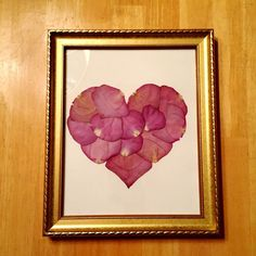 This heart is made out of dried flowers from a loved one's funeral. This is a special way to not let all of the flowers from that day simply die and get thrown away.: