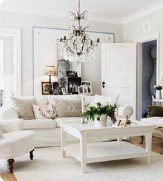 family room, bright airy, slipcovered white sofa, chandelier, easy elegance inviting living room