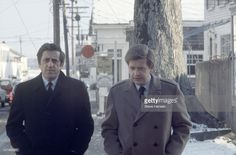 Civil Defense official Raymond LaRosa and lawyer Chase Tretter walk along a sidewalk during the Inquest into the death of Mary Jo Kopechne, Edgartown, Massachusetts, January 1970. The pair were friends of US Senator Ted Kennedy and had helped him when Kennedy had driven his car off of a bridge on Chappaquiddick Island (on July 18, 1969)--Kennedy swam to the shore, but his passenger, Mary Jo Kopechne, was found dead in the car hours later.