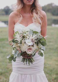 rose, Veronica, astilbe, wax flower, seeded eucalyptus, football mums bridal bouquet | photos by Nicole Roberts | 100 Layer Cake