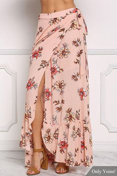 An effortless maxi skirt in a crepe bodice with a floral print all throughout. And it also features a wrap bodice with thick straps waist straps. With a crop top, delicate necklace and clog heels will be perfect!