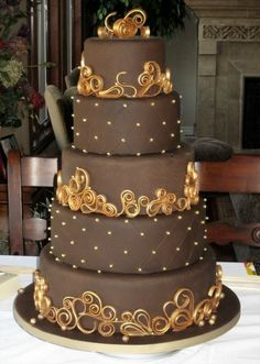 Chocolate & Gold Wedding Cake - My entry in a Chocolate Wedding Cake Contest. Chocolate fondant with chocolate gumpaste scrollwork. I painted the scrollwork with luster dust. Beautiful Wedding Cakes, Gorgeous Cakes, Pretty Cakes, Amazing Cakes, Quilling Cake, Rodjendanske Torte, Round Wedding Cakes, Cake Wedding, Wedding Bands