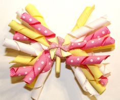 Pink and yellow windmill $6