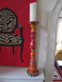 Love this artist's painting and painted candle stick