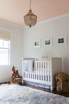 A blush ceiling makes for an adorable nursery