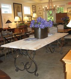 British Cottage style is all about being beautiful and tough at the same time.  Like this scrubbed pine table top married with the sensuous hand forged wrought iron and brass legs--it's strong and it's sexy.  Furniture should never be boring!