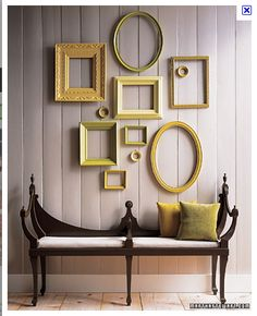 eclectic frames, clustered placement - stair wall...