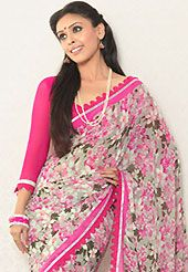 Era with extension in fashion, style, Grace and elegance have developed grand love affair with this ethnical wear. This off white and pink faux georgette saree is nicely designed with floral print, lace and graceful patch border. Saree gives you a singular and dissimilar look. Matching pink blouse is available. Slight color variations are possible due to differing screen and photograph resolution.