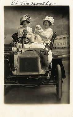 +~+~ Antique Photograph ~+~+  One's holding a baby and one's holding a cat with nary a hand on the wheel!  Good thing the car is a prop.