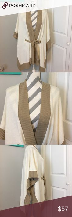 New York & Company Sweater Open front tie waist poncho. Tan/ Cream.  One size fits most    Used once    Excellent condition New York & Company Sweaters Shrugs & Ponchos