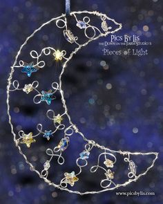 Silver Crescent Moon Starcatcher with 17 Star Crystals amidst the Cloud Wisps: Pieces of Light Ornament by Lisa Marie Ford of the DownontheFarmStudio Etsy Shop.