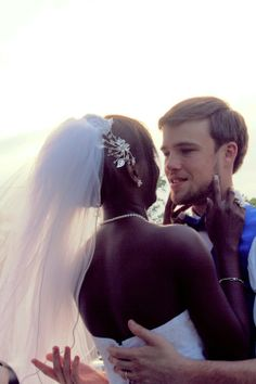 Gorgeous interracial couple on their wedding day. I love the way he is looking at his new wife. #love #wmbw #bwwm