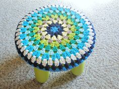Granny Square Stool Cover -- The Spot has a stool in DESPERATE need of one of these... so I think I'm going to make it for them! :)