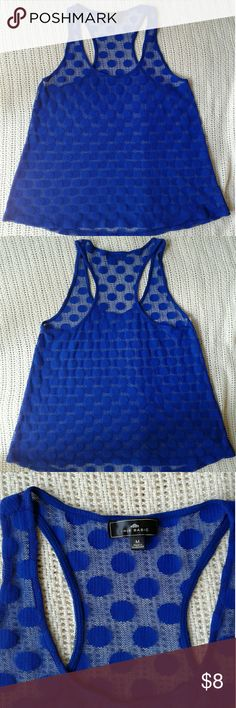 Sleeveless shirt Like brand new sleeveless shirt. See through royal blue polkadots, size medium Tops Tank Tops