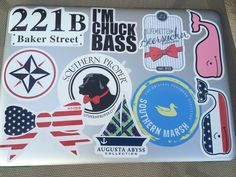My Laptop Cover~ Laptop- Macbook 13in (no retina) 221B- Sherlock sticker is from Hot Topic I'm Chuck Bass- Red Bubble Whales- Vineyard Vines  Dog- Southern Proper  American Bow- Kiss My Southern Sass Boat- Augusta Abyss Collection  Seersucker- Lauren James  Duck- Southern Marsh Compas- message me, I don't have the name with me ~If you want any of the links just respond down below and I will provide the link:)