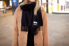 Camel coat and black Acne scarf