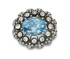 Aquamarine and diamond brooch, circa 1880. Centring on an oval aquamarine within a scalloped frame of circular-cut diamonds, detachable brooch fitting.