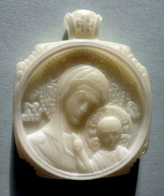 Carved miniature icon Our Lady of Kazan 4×3.3×0.65 cm; Tagua nut, 2012. Artist is Elena Nikolenko