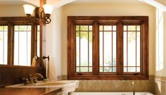 ADORE the wood, and the divided lights of these windows. GREAT bathroom look.