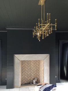 Front living room inspiration: Dark walls and herringbone fireplace topped off with a brass chandelier-- Tracery Interiors Fireplace Surrounds, Fireplace Design, Fireplace Mantels, Fireplaces, Mantle, Modern Fireplace, Tiled Fireplace, Fireplace Lighting, Fireplace Makeovers