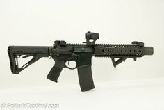 short barrelled AR15 with an integrated suppressor kind of like the MP5SD variants