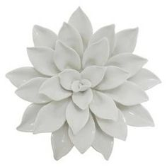 "The Porcelain Flower Wall Decor brings texture and natural patterning to your wall. It's made of ceramic with a glossy glaze in clean, crisp white. With its 8"" diameter, this beautiful wall accent is perfect for smaller walls or groupings of wall art."
