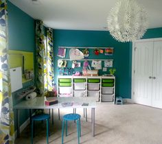 Teal ... and check out the dandelion puff light fixture!