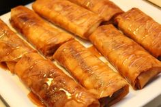 Crispy Banana Turon (Filipino dessert). Slices of ripe banana are wrapped and fried until golden brown, and drizzled with a bit of honey. Delicious!
