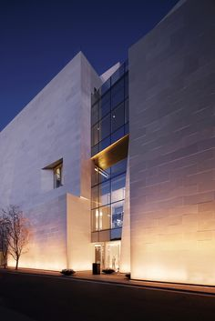 Boontheshop byPeter Marino Architect, Seoul, South Korea. The exterior cladding materials all have extremely high albedos: polished white marble and stamped, mirror polished stainless steel panels.