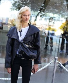 Aymeline Valade in a Loewe jacket and with a Loewe bag at Paris Fashion Week SS 2016 // Phil Oh for Vogue