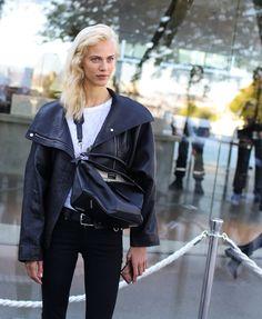 Aymeline Valade in a Loewe jacket and with aLoewe bag