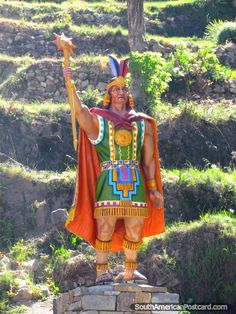 Monument of Inca warrior in orange and green at Isla del Sol, Lake Titicaca, Bolivia.  Photo: southamericanpostcards.com