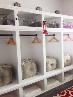 Locker style storage for bunk room with vintage gym baskets and hooks.