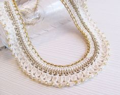 This collar necklace is made of cotton thread, gold lame thread, gold tone chain and gold glass seed beads. It fastens with gold tone clasp. The collar #crochetnecklace #crochet