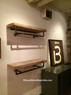 Custom reclaimed wood shelving with piping by Good Wood Nashville, for Barre 3 in the Gulch.