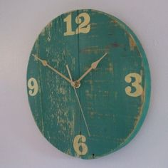 This wall clock has been handmade in Norfolk from reclaimed wood. It has been cut to shape and assembled to make the round clock face. The face of the clock has a green distressed paint effect. The numerals have been hand painted in Iridescent Gold acr. Gold Wall Clock, Gold Acrylic Paint, Paint Effects, Green Turquoise, Diy Painting, Green And Gold, Chalk Paint, Decorative Items, Different Colors