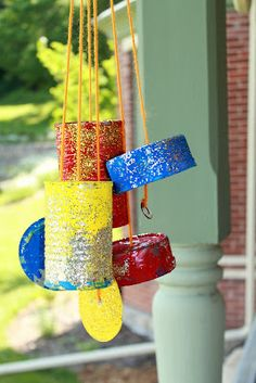 Upcycling tin cans to make wind chimes with the kids.